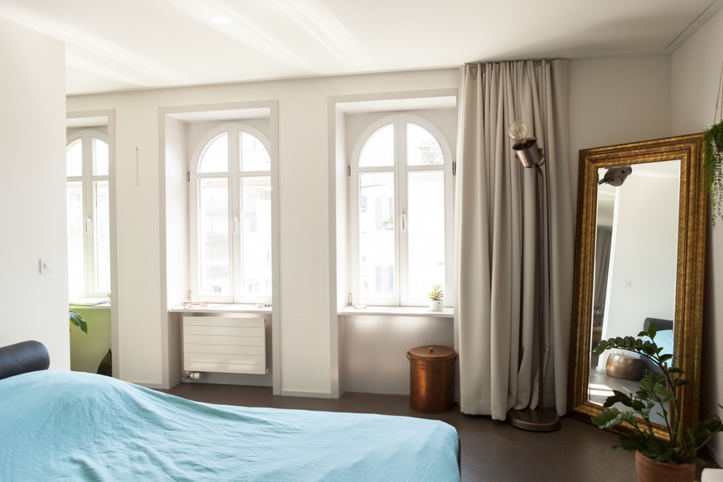 Well-lit bedroom with duvet cover and floor lamp by IKEA