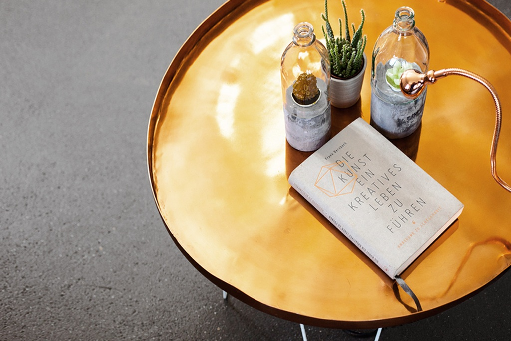 Home-made coffee table with flexible reading lamp by IKEA