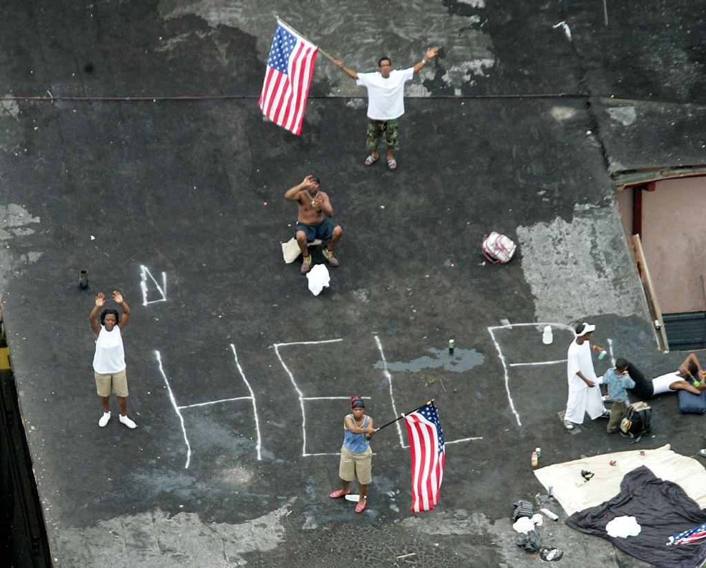 7 People Signal Help On A Roof After Hurricane Katrina