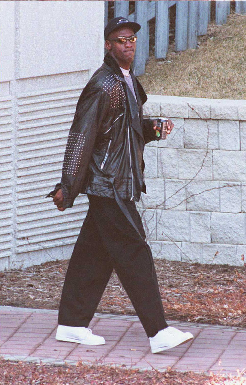 best sneakers b9afa bd62c ... Michael Jordan in a studded leather jacket, the set of sneakers are  each made from a leather upper and covered with metal studs.